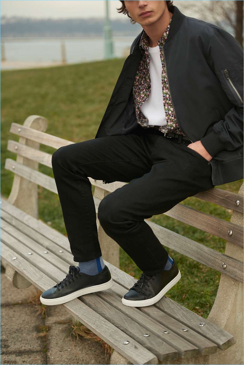 Complementing Club Monaco's timeless style, its new leather sneakers look great with the brand's black chinos. A bomber jacket, floral shirt, and pocket crew complete a must-try outfit.