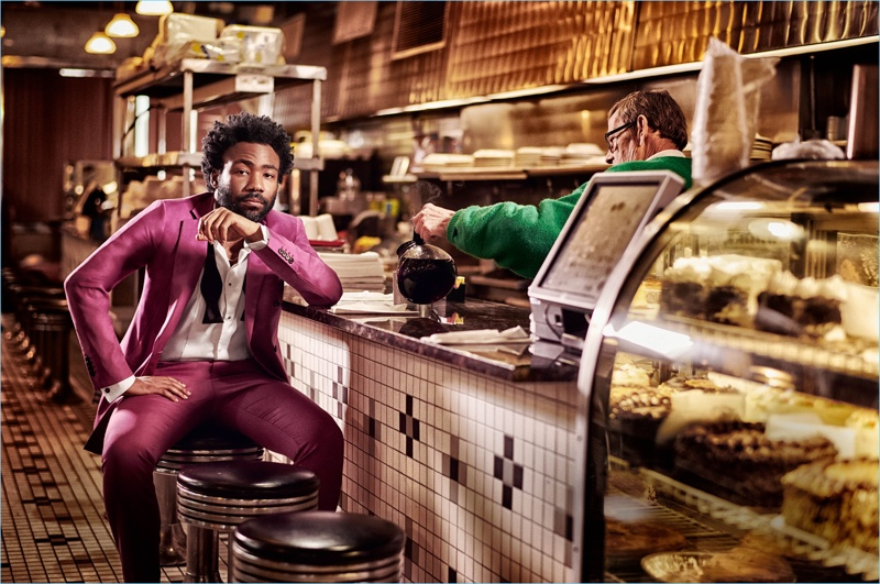 Stopping by a diner, Donald Glover wears a look by Calvin Klein.