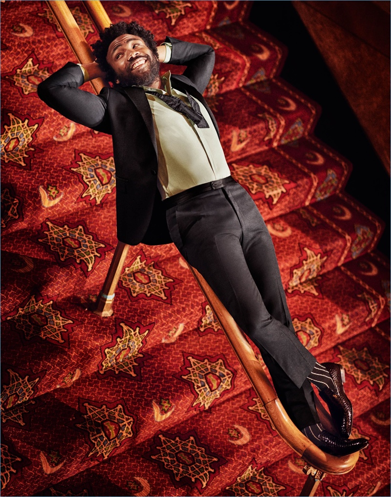 Connecting with Esquire, Donald Glover wears a tuxedo and bow-tie by Lanvin. He also dons a Maison Margiela shirt, Paul Andrew loafers, and Haider Ackermann socks.