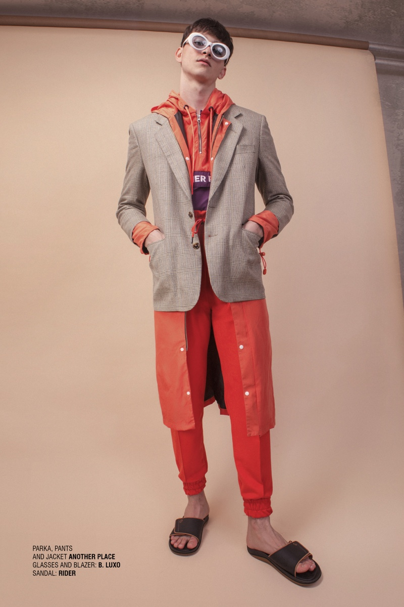 Vitor wears sandals Rider, glasses and blazer B. Luxo, parka, pants, and jacket Another Place.
