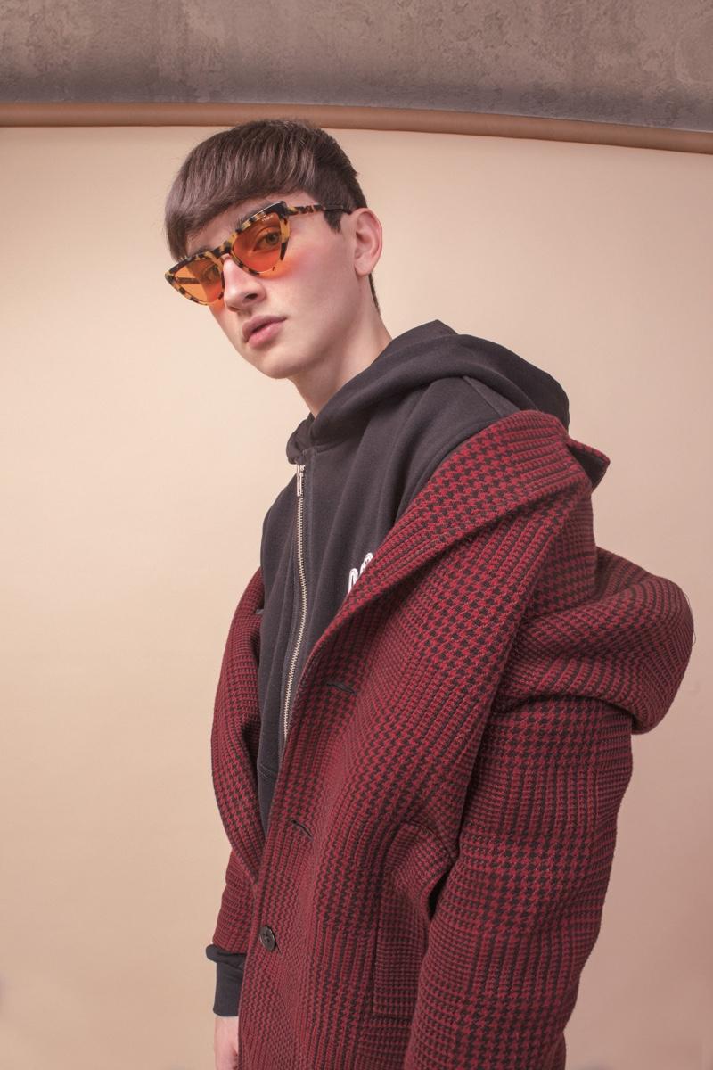 Vitor wears vintage coat, sweatshirt Igor Dadona, shorts Another Place, socks Gucci, and sandals Rider.