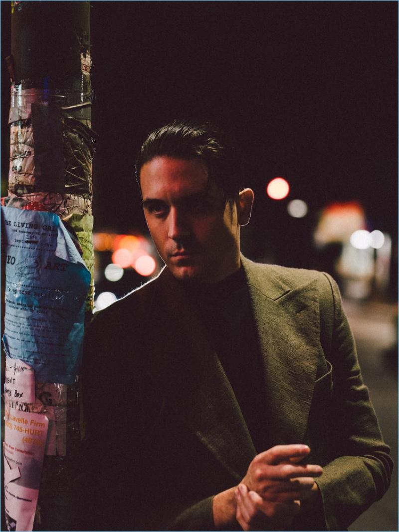 Rapper G-Eazy rocks a Lanvin coat with a Hugo Boss top.
