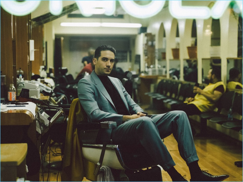 Taking to the barber shop, G-Eazy wears an Ermenegildo Zegna Couture suit with a Hermès top.