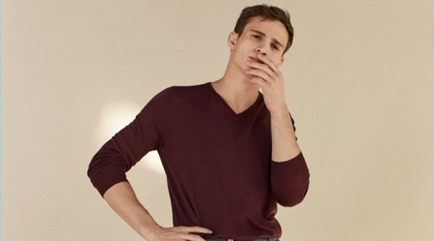 A smart vision, Julian Schneyder wears a Massimo Dutti v-neck sweater and trousers.