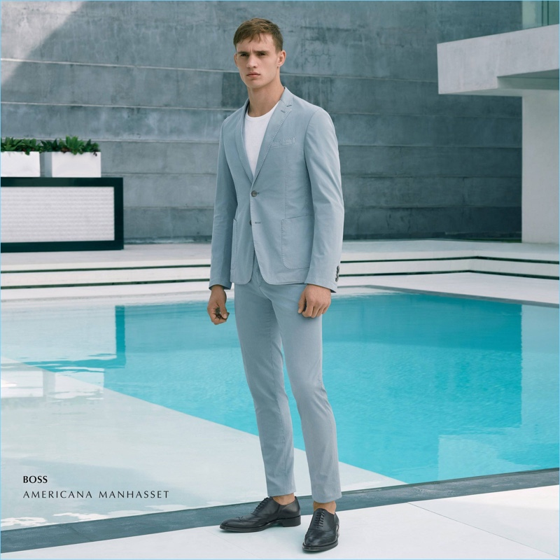 Julian Schneyder wears a BOSS suit.