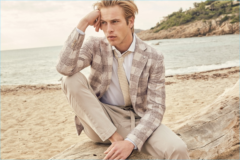 Taking to the beach, Jules Raynal wears a neutral hued suit from L.B.M. 1911.