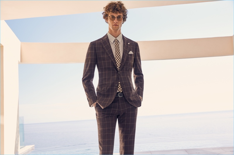 Donning a windowpane print suit, Marçal Taberner is dapper in Luigi Bianchi Mantova.