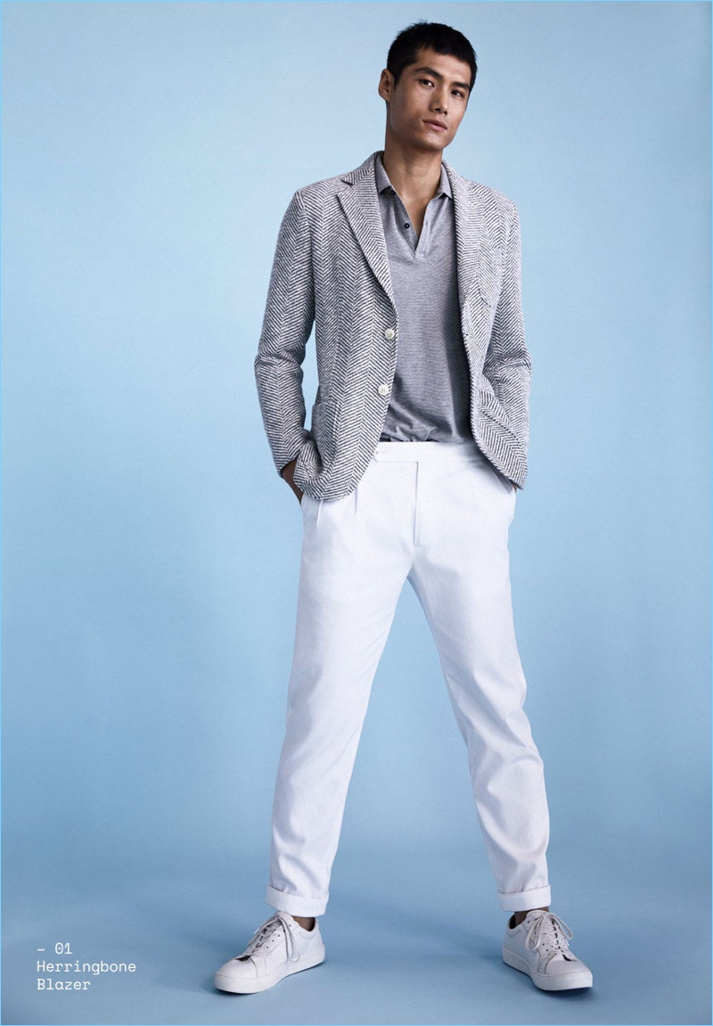 Hao Yun Xiang is a spring vision in a herringbone blazer and white pants from Massimo Dutti.
