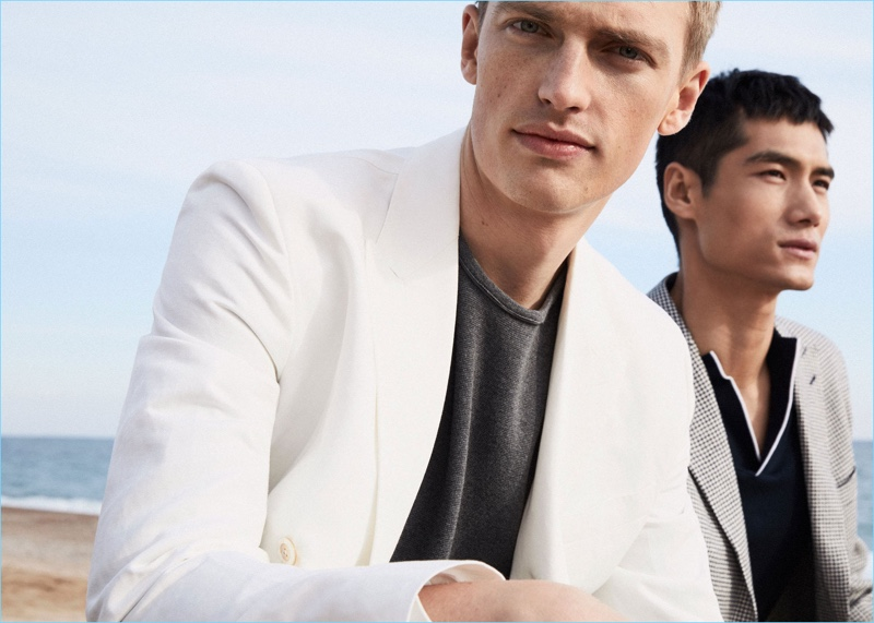 Models Victor Nylander and Hao Yun Xiang star in an editorial for Massimo Dutti.