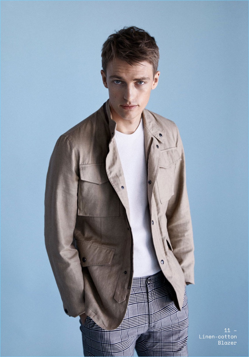 Taking to the studio, Victor Nylander wears a linen blazer from Massimo Dutti's spring lineup.