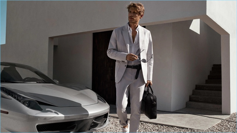 Connecting with Michael Kors for spring-summer 2018, Baptiste Radufe dons a light colored suit.