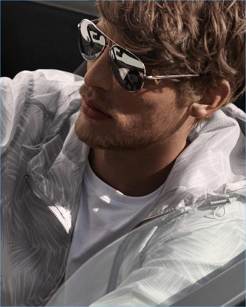 A sporty vision, Baptiste Radufe dons sunglasses by Michael Kors.