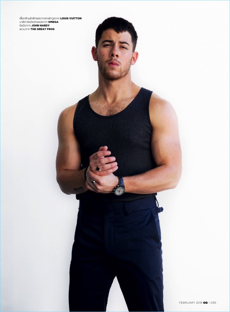 Sporting a form-fitting look, Nick Jonas wears Louis Vuitton.