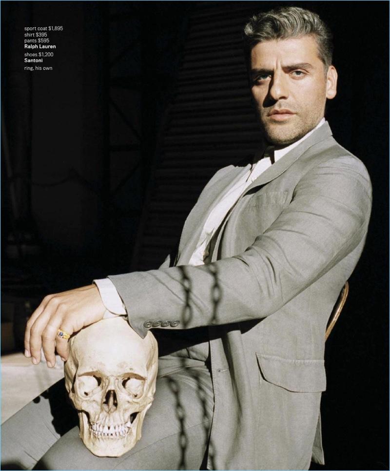 An elegant vision, Oscar Isaac wears a Ralph Lauren look with Santoni shoes.