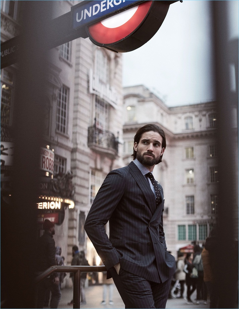 Jamie Jewitt is dressed to impress with a Reiss pinstripe double-breasted blazer and trousers. He also wears a houndstooth check shirt and polka dot tie.