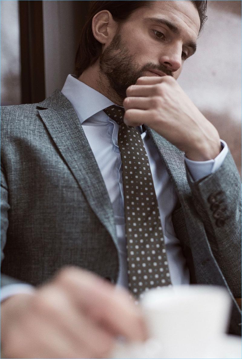 Embracing a sartorial flair, Jamie Jewitt dons a Reiss blazer, shirt, and tie.