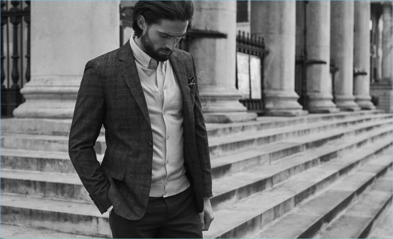 Reiss proposes a fresh alternative to the traditional suit look with a blazer and cardigan. Here, Jamie Jewitt wears it with a shirt and paisley print pocket square.