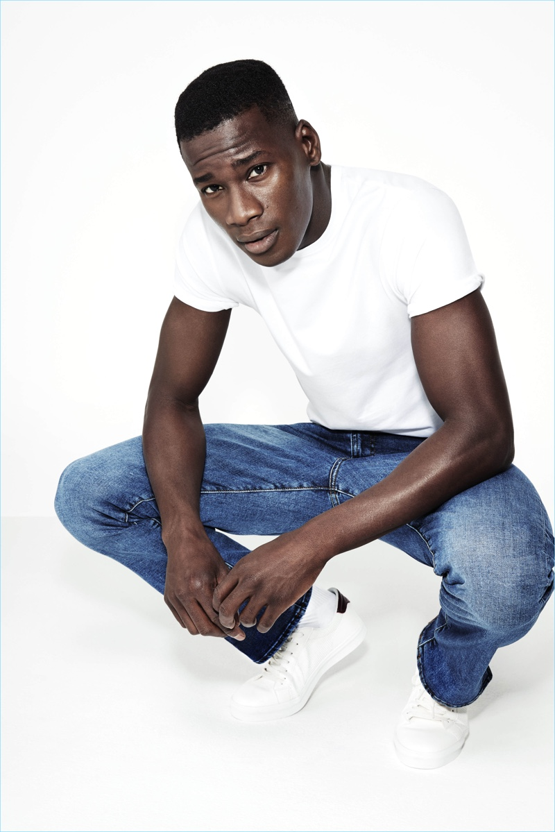 b3b78ea251c Top model David Agbodji wears a simple tee and denim jeans from River Island .