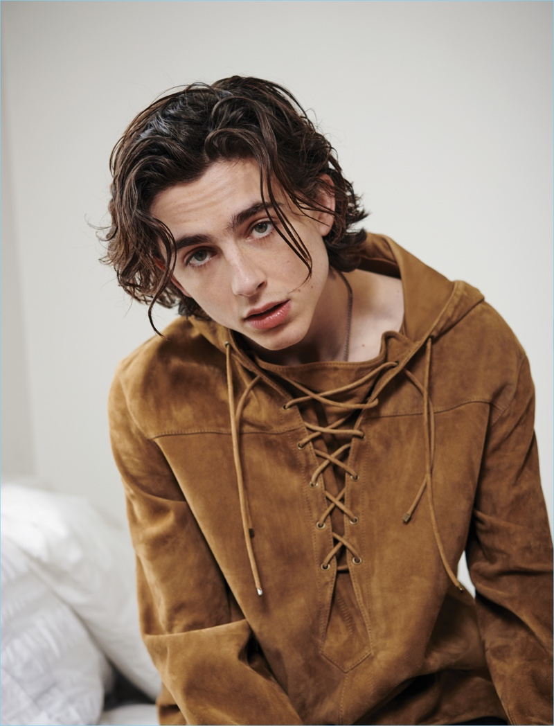 Connecting with VMAN, Timothée Chalamet wears a suede Saint Laurent top.