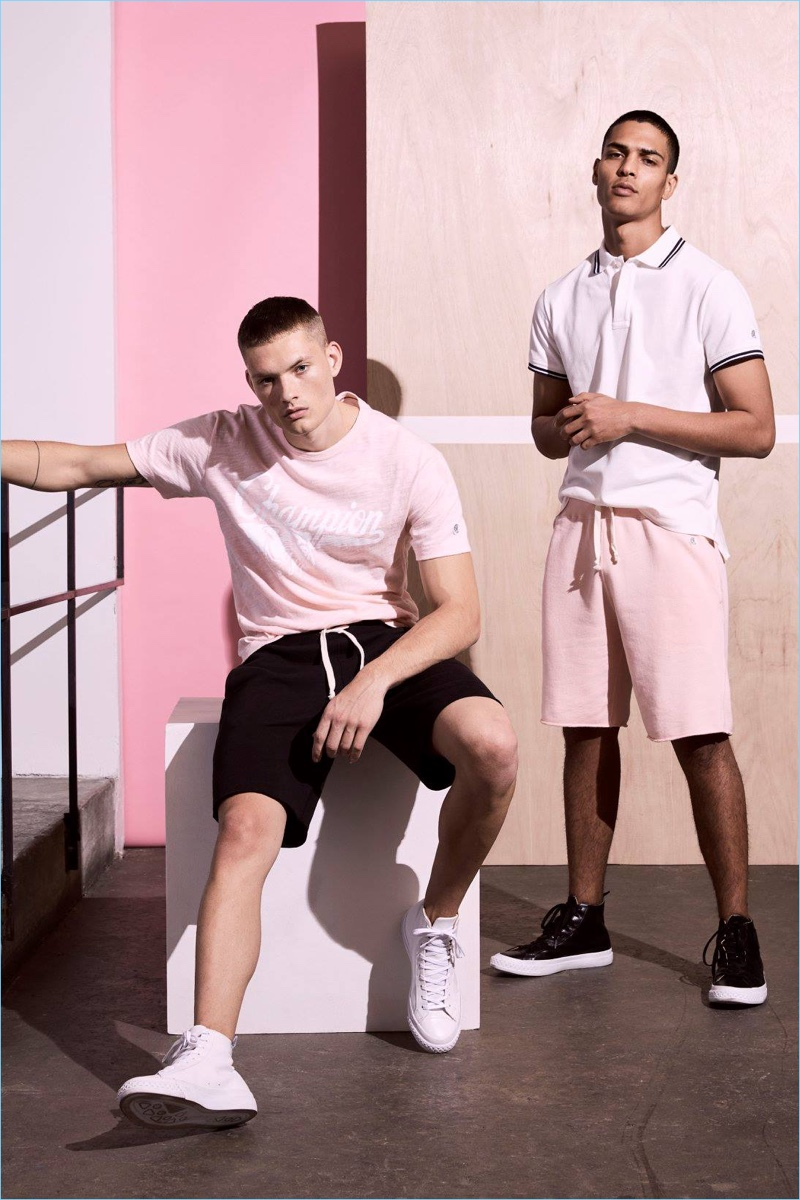 Left to Right: William Los wears a Todd Snyder x Champion graphic t-shirt and sweatshorts. Geron McKinley models a tipped pique polo and sweatshorts.
