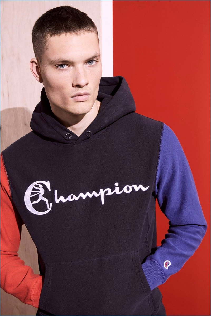 William Los sports a color-blocked hoodie from Todd Snyder's Champion collaboration.