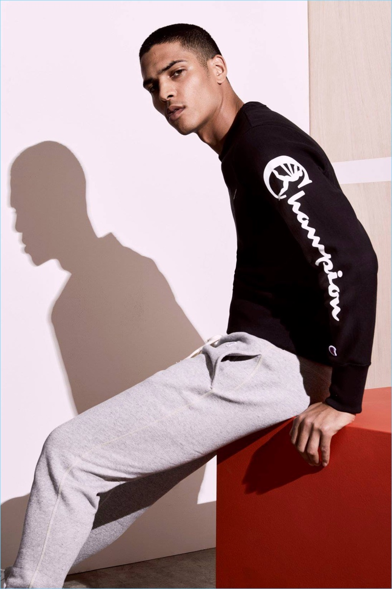 Geron McKinley sports a graphic sleeve sweatshirt and sweatpants from Todd Snyder's Champion collaboration.