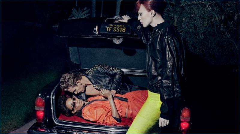 Karen Elson puts Adam Senn and Joan Smalls in the trunk for Tom Ford's spring-summer 2018 campaign.