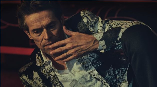 Connecting with Essential Homme, Willem Dafoe sports a dapper look from Alexander McQueen.