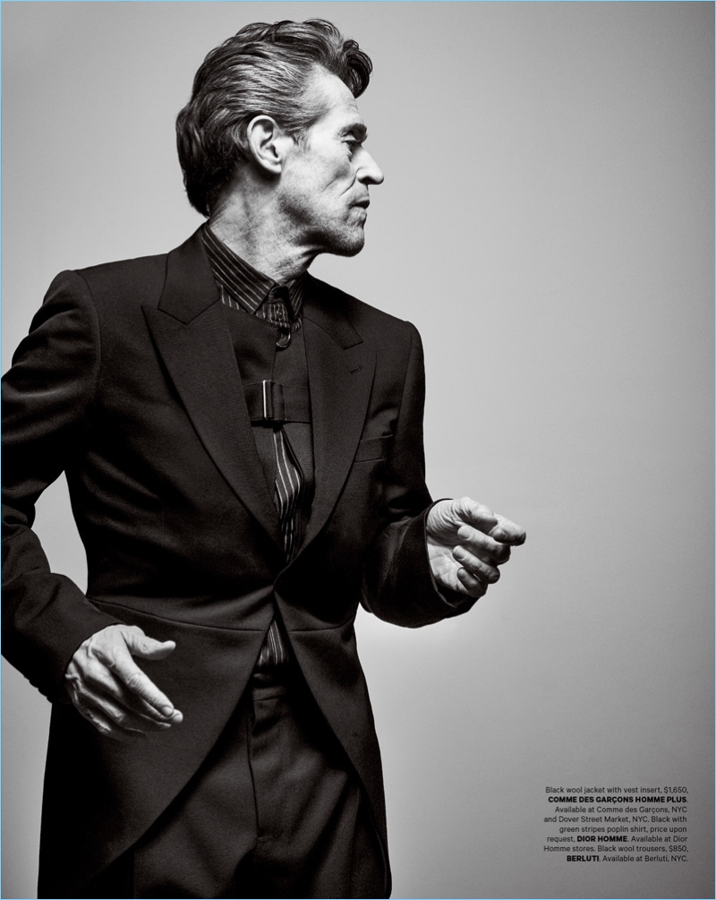 Delivering a side profile, Willem Dafoe wears a Comme des Garçons jacket. Dafoe also dons a Dior Homme shirt and Berluti trousers.