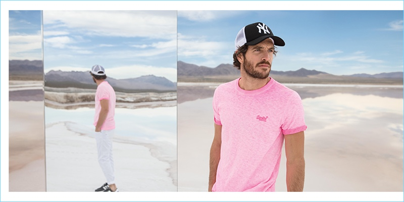 Going casual, Justice Joslin wears a Superdry t-shirt and New Era cap.