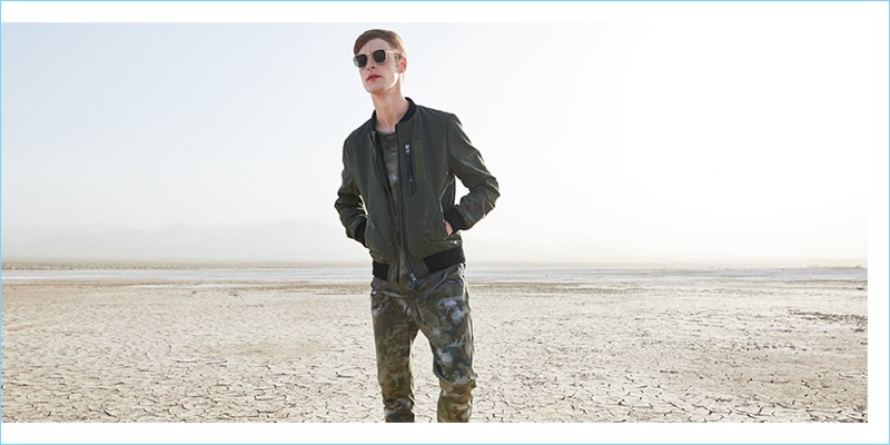 Making a military-inspired style statement, Roberto Sipos rocks a Tigha bomber jacket and Selected sunglasses.