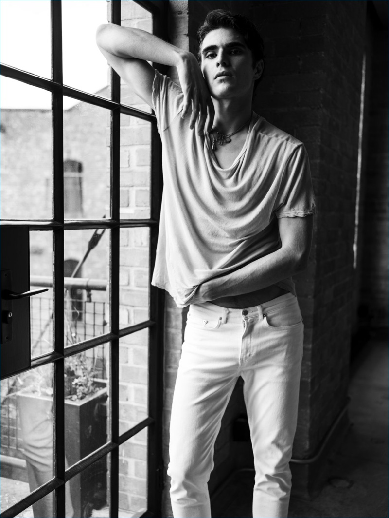 Rocking white denim jeans, Diego Villarreal fronts BLK DNM's spring-summer 2018 campaign.