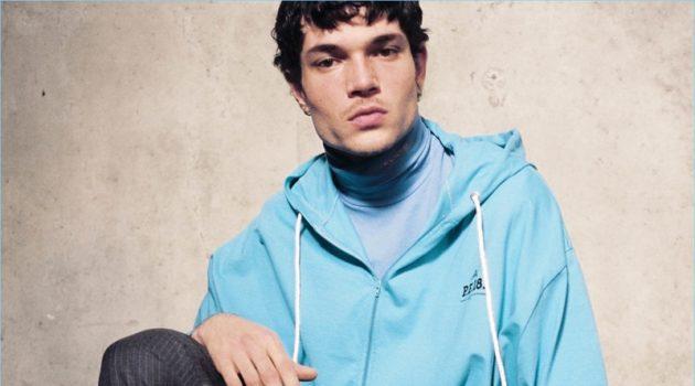 Model Luka Isaac sports a Balenciaga hoodie, Calvin Klein t-shirt, and Gosha Rubchinskiy trousers.