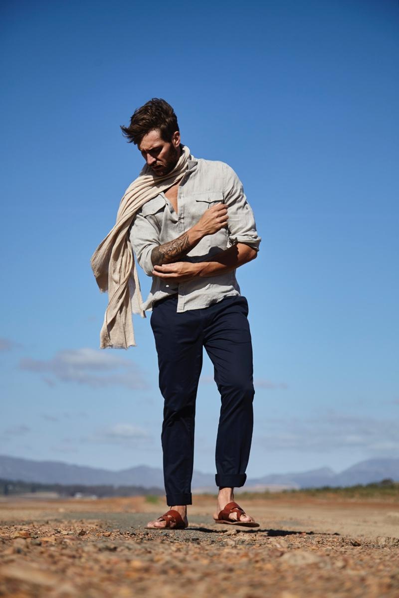 Benjamin wears scarf POLO Ralph Lauren, shirt Hermès, trousers Cerruti, and sandals Clarks.