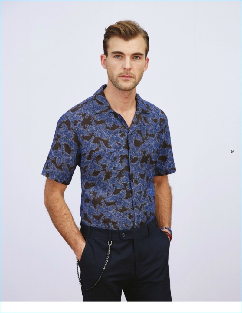 Patrick Kafka dons a short-sleeve patterned shirt with trousers from Beymen Club.