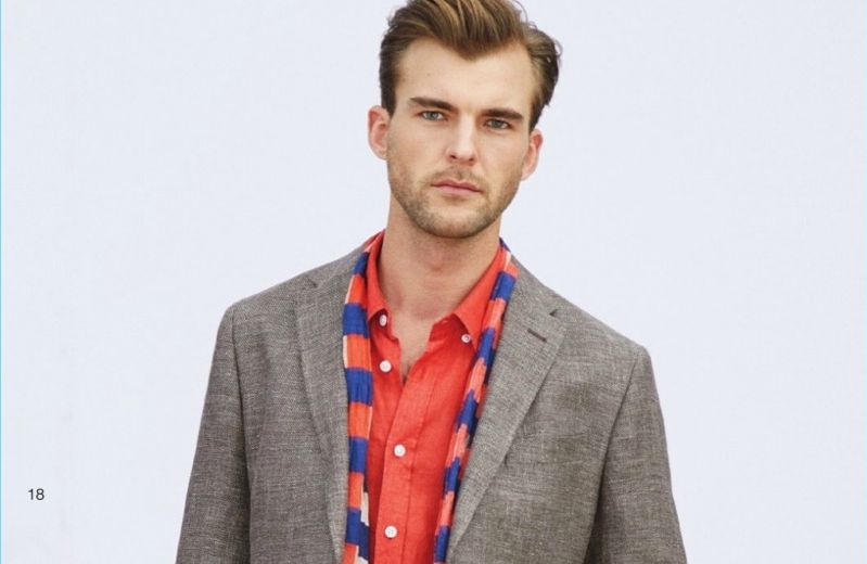 Embracing Beymen Collection's latest styles, Patrick Kafka accessorizes with a scarf.