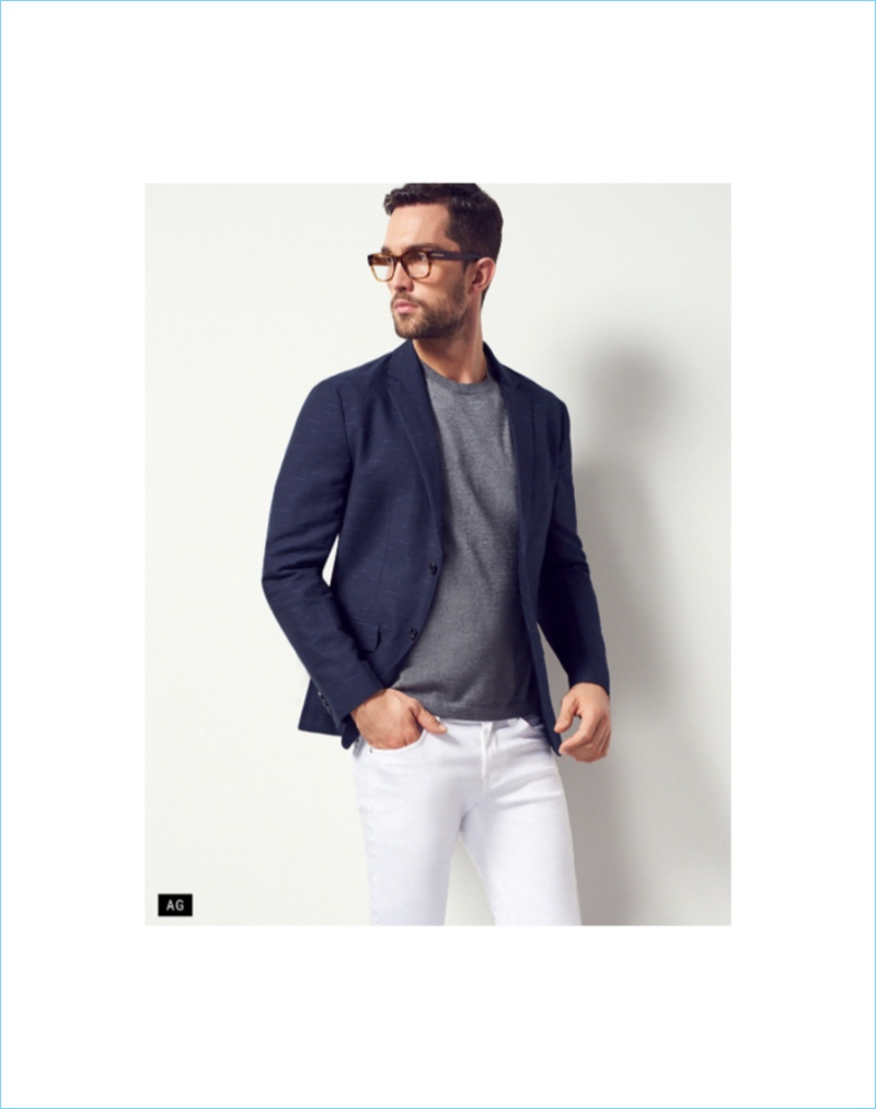 White Out: Wearing AG denim, Tobias Sorensen pairs white jeans with a smart sport coat.
