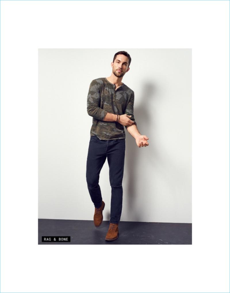 Take It Black: Tobias Sorensen rocks slim-fit jeans in black from Rag & Bone.