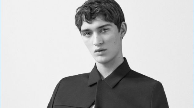 Otto Lotz wears a round-neck t-shirt, cotton-wool blend jacket, and slim-fit trousers with pleats by COS.