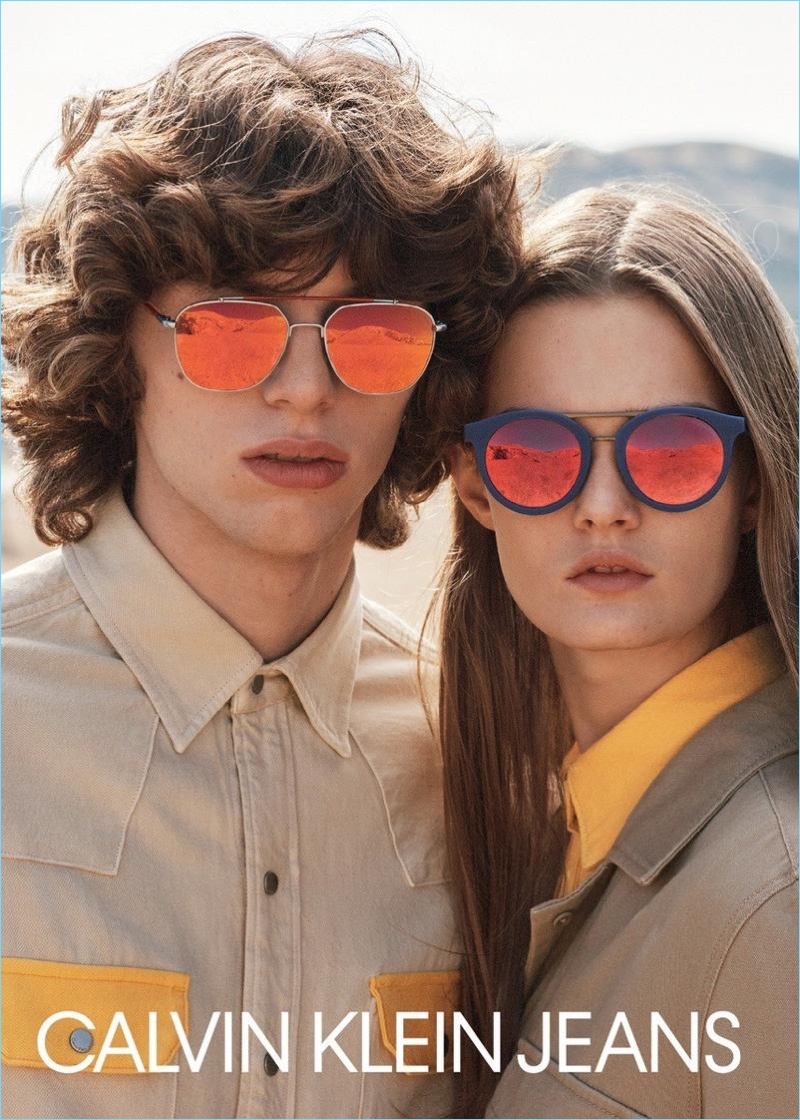 Models Fernando Albaladejo and Lulu Tenney rock sunglasses for Calvin Klein Jeans' spring-summer 2018 campaign.