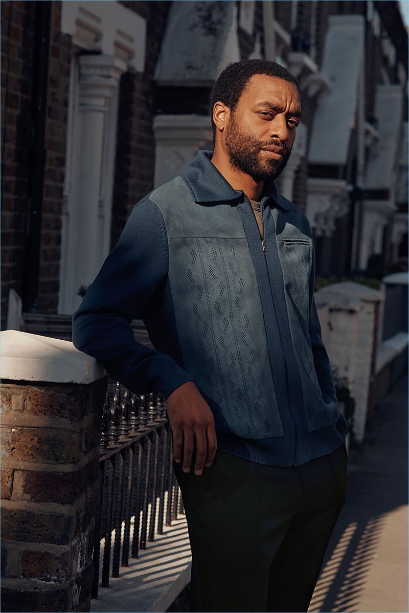 Connecting with Mr Porter, Chiwetel Ejiofor wears a Prada wool jacket with a Tom Ford t-shirt and Berluti trousers.