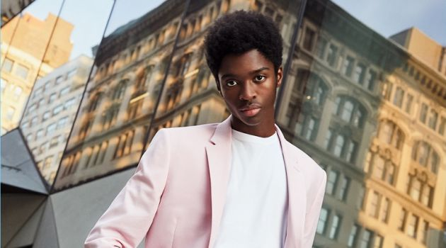 Model Alton Mason dons a pink suit from Express' latest lineup.