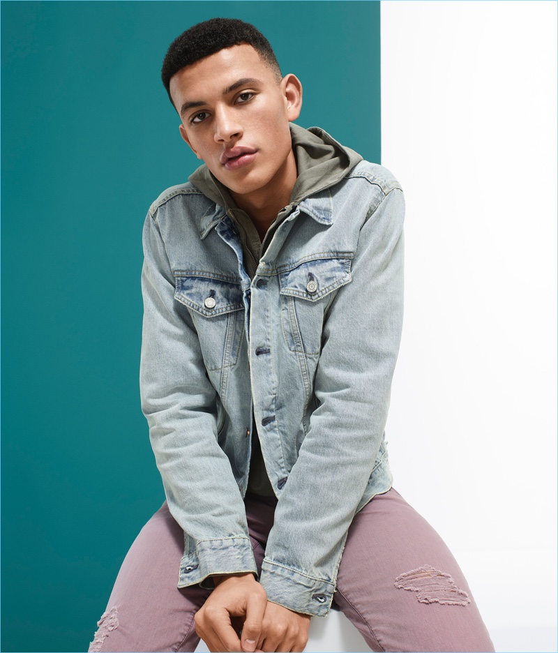 Adil Haddaoui wears a Gap distressed denim jacket and dusty mauve jeans.