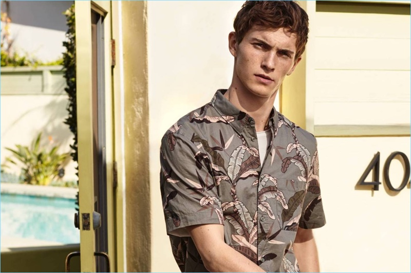 Model Luc Defont-Saviard dons a printed short-sleeve shirt from H&M.