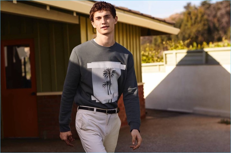 Going casual, Luc Defont-Saviard wears a H&M sweatshirt and pleated pants.