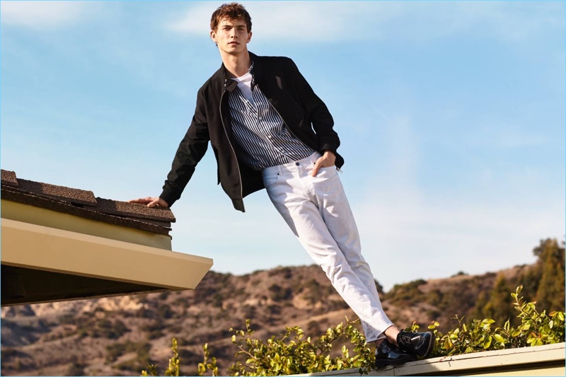 A casual vision, Luc Defont-Saviard sports a H&M jacket with a short-sleeve striped shirt and skinny-fit pants in white.