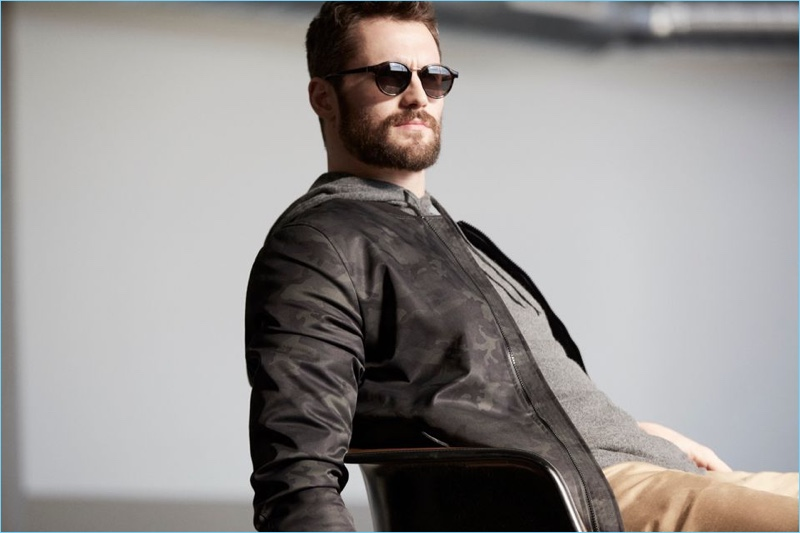 Going casual, Kevin Love wears a camouflage print jacket by Banana Republic.
