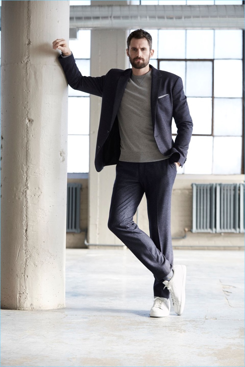 Embracing a contemporary look, Kevin Love wears a Banana Republic suit with sneakers and a sweatshirt.