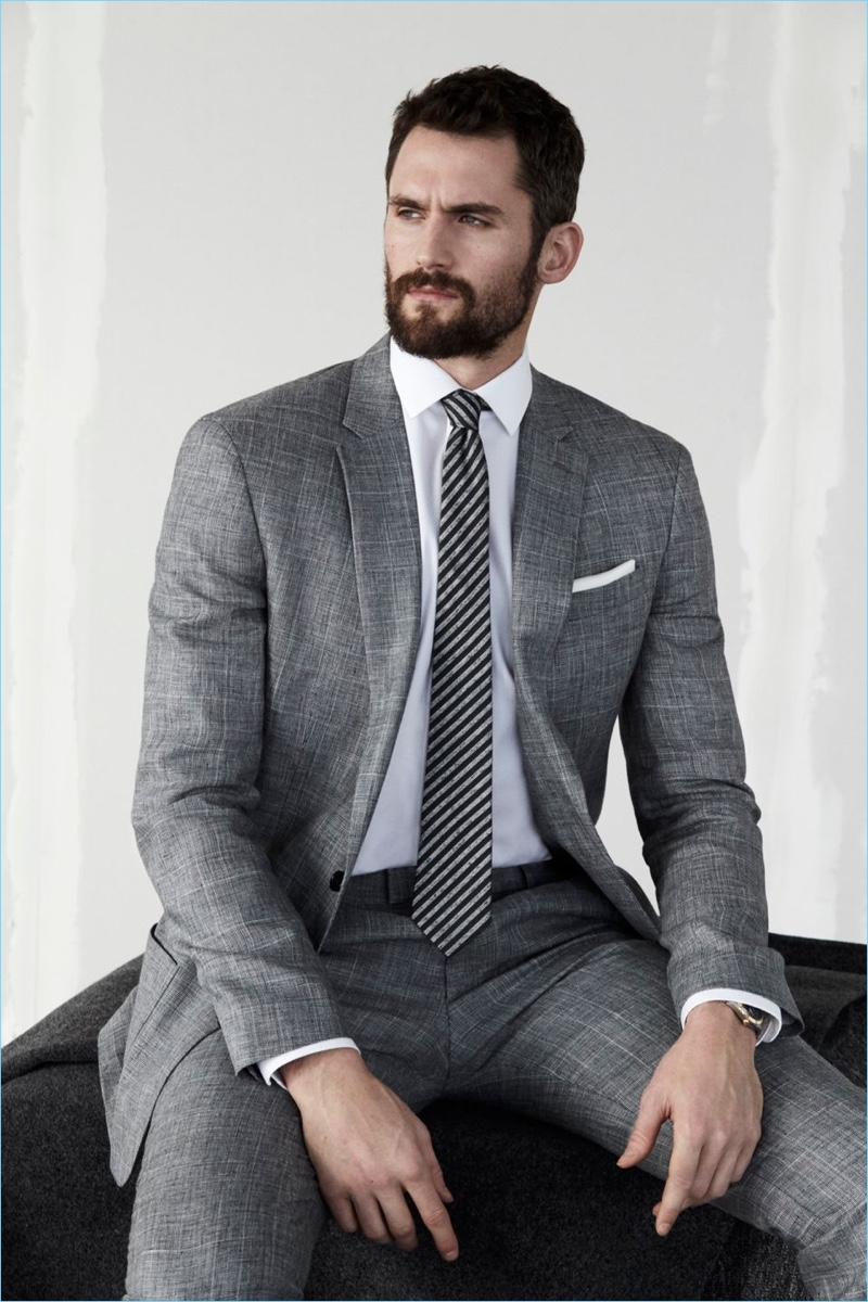 Kevin Love dons a grey suit by Banana Republic.