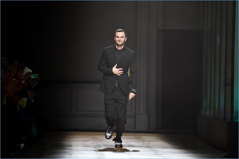 Kris Van Assche gives his final bow for Dior Homme on January 20, 2018 in Paris, France.